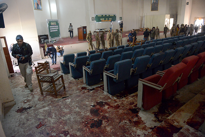Pakistani soldiers and media gather in a ceremony hall at an army-run school a day after an attack by Taliban militants in Peshawar on December 17, 2014. (AFP Photo / A Majeed)