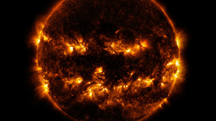 This NASA image obtained October 10, 2014 shows active regions on the sun as they gave it the appearance of a jack-o'-lantern.(AFP Photo / NASA)