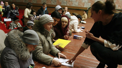 Refugees from eastern Ukraine fill a form to get social benefits at a temporary accommodation centre on December 25, 2014 in Russia's Rostov region. (AFP Photo/Sergey Venyavsy)