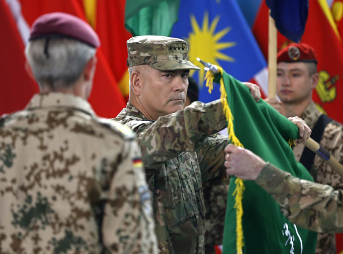 U.S. General John Campbell (C), commander of NATO-led International Security Assistance Force (ISAF), folds the flag of the ISAF during the change of mission ceremony in Kabul, December 28, 2014. (Reuters/Omar Sobhani)