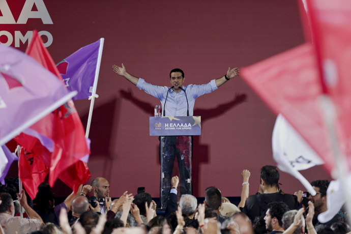 Leader of leftist main opposition Syriza party and candidate for the European Commission presidency Alexis Tsipras waves at party supporters during a pre-election campaign rally in Athens. (Reuters/Alkis Konstantinidis)