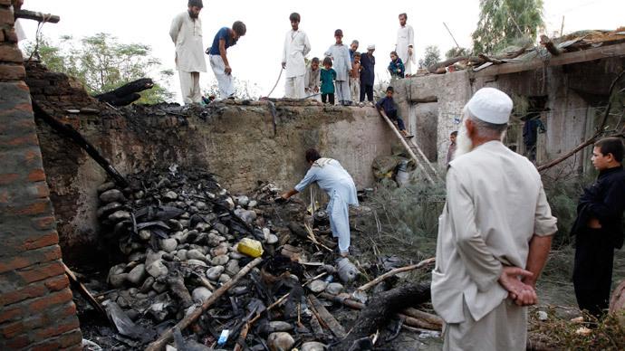 Afghans inspect a damaged house after a drone crash last night in Jalalabad.(Reuters / Parwiz )
