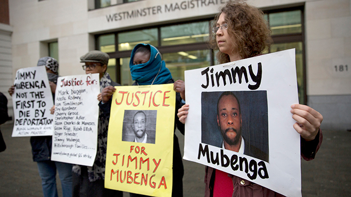 Supporters of Jimmy Mubenga hold placards outside Westminster Magistrates Court in London. (Reuters / Neil Hall)