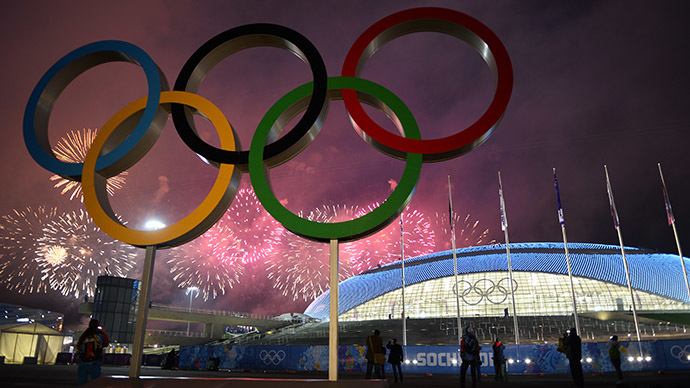 Fireworks explode around the Fisht Olympic Stadium at the end of the Closing Ceremony of the Sochi Winter Olympics on February 23, 2014 at the Olympic Park in Sochi. (AFP Photo/Jonathan Nackstrand)