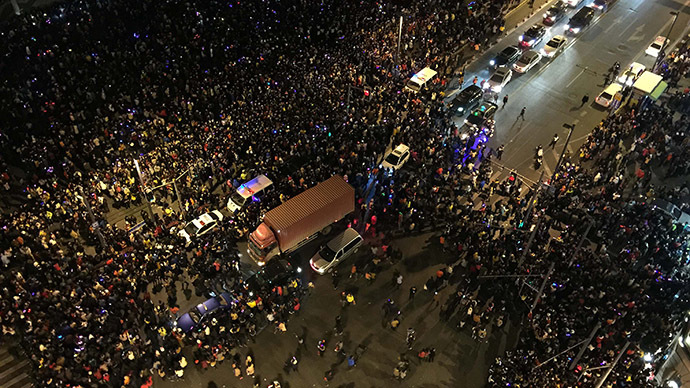 36 killed in Shanghai New Year's stampede after crowd rushes for fake money