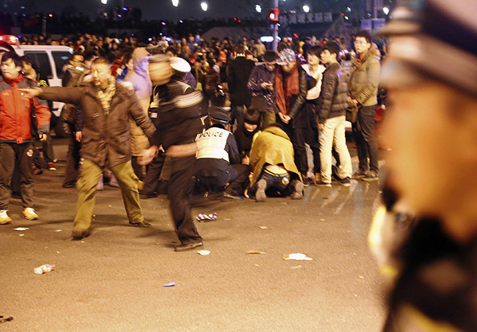Police control the site after a stampede occurred during a New Year's celebration on the Bund, a waterfront area in central Shanghai, January 1, 2015. (Reuters/Stringer)