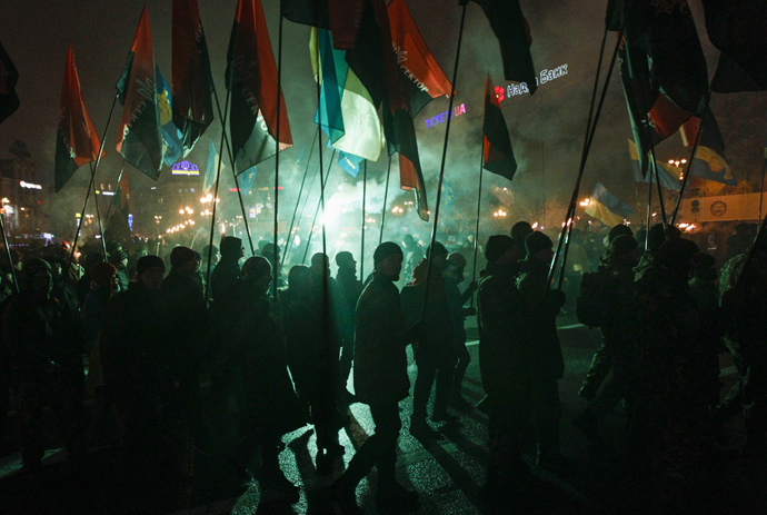 Activists of the Svoboda (Freedom) and Right Sector Ukrainian nationalist parties hold flags as they take part in a rally to mark the 106th birth anniversary of Stepan Bandera, one of the founders of the Organization of Ukrainian Nationalists (OUN), in Kiev January 1, 2015. (Reuters / Valentyn Ogirenko)