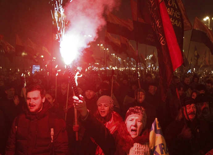 Activists of the Svoboda (Freedom) and Right Sector Ukrainian nationalist parties shout slogans as they take part in a rally to mark the 106th birth anniversary of Stepan Bandera, one of the founders of the Organization of Ukrainian Nationalists (OUN), in Kiev January 1, 2015. (Reuters / Valentyn Ogirenko)