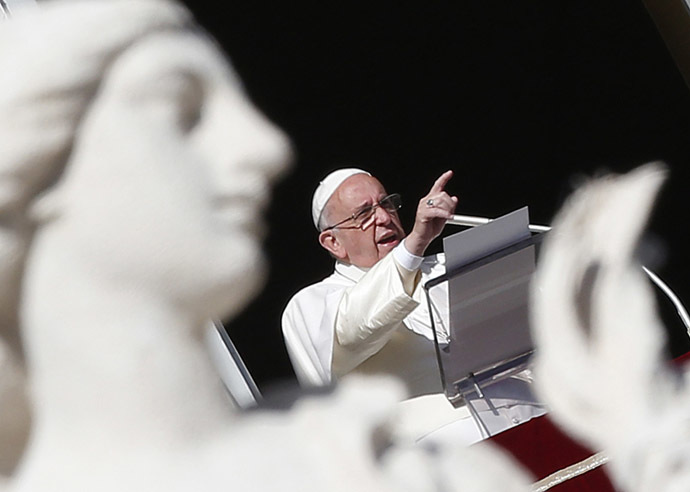 Pope Francis gestures as he leads the Angelus prayer in Saint Peter's Square at the Vatican January 1, 2015. (Reuters/Alessandro Bianchi)