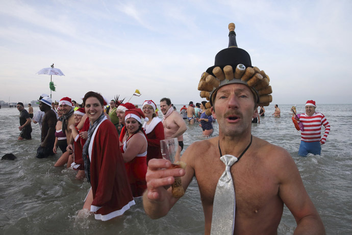 People wearing costumes participate in a traditional New Year's Day swim in Malo-les-Bains, northern France January 1, 2015. (Reuters/Pascal Rossignol)