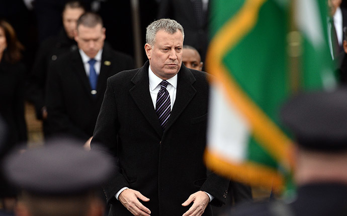 New York City Mayor Bill de Blasio attends the funeral of New York Police Department (NYPD) officer Wenjian Liu in New York's borough of Brooklyn on January 4, 2015. (AFP Photo/Jewel Samad)