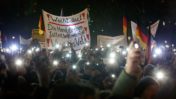 "Participants use lights on their portable phones as they take part in a demonstration called by anti-immigration group PEGIDA, a German abbreviation for ""Patriotic Europeans against the Islamization of the West"", in Dresden January 5, 2015.(Reuters / Fabrizio Bensch)"
