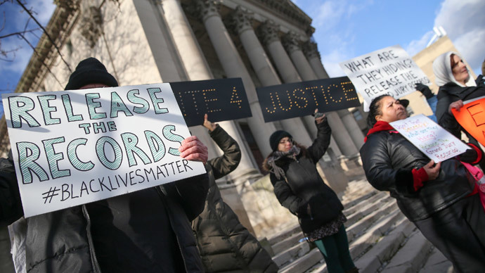 Demonstrators stand outside the State Supreme Court before the hearing for Eric Garner, who was killed after a policeman put him in a chokehold while being arrested for peddling loose cigarettes, in the Staten Island borough of New York January 5, 2015.(Reuters / Shannon Stapleton)