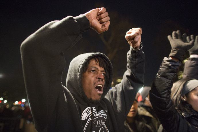 "A protester yells ""I can't breathe"" during a protest against the decision by a Staten Island grand jury not to indict a police officer who used a chokehold in the death of Eric Garner in July, on December 4, 2014 in Boston, Massachusetts. (Scott Eisen/Getty Images/AFP)"
