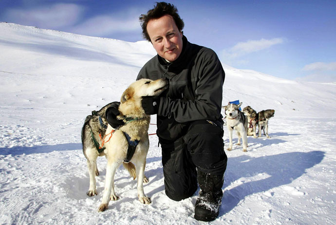 David Cameron stands on top of the Scott-Turner glacier with husky Troika on the island of Svalbard, Norway April 20, 2006. (Reuters)