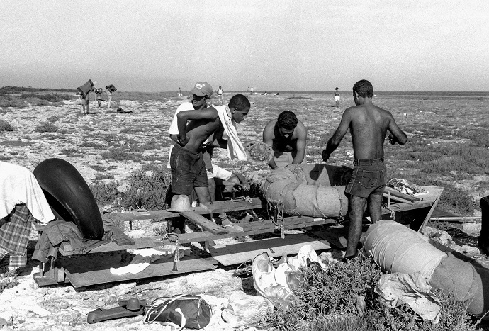 People prepare to launch a makeshift boat into the Straits of Florida towards the US, on the last day of the 1994 Cuban raft exodus in Havana (Reuters/Rolando Pujol Rodriguez)