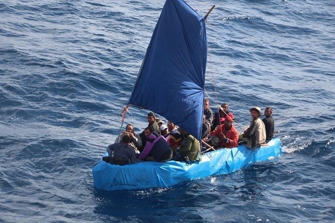 Cuban migrants sail a rustic vessel south of Key West, Florida, Jan. 1, 2015. The 24 were later repatriated to Bahia de Cabañas, Cuba (US Coast Guard)