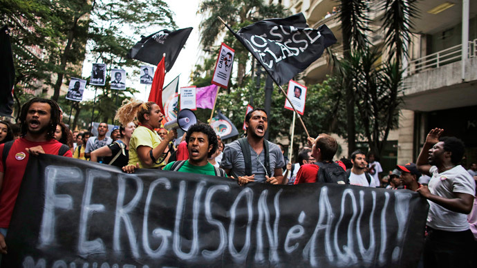 Demonstrators protest against police violence and the Ferguson shooting of Michael Brown, in Sao Paulo.(Reuters / Nacho Doce)