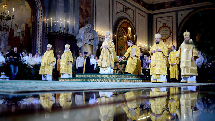 Patriarch Kirill of Moscow and All Russia (center) during the Christmas Eve service at the Cathedral of Christ the Savior in Moscow. (RIA Novosti / Vladimir Astapkovich)