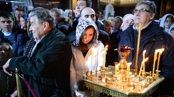Believers seen here at the Cathedral of Christ the Savior in Moscow prior to the Christmas Eve service.(RIA Novosti / Vladimir Astapkovich)