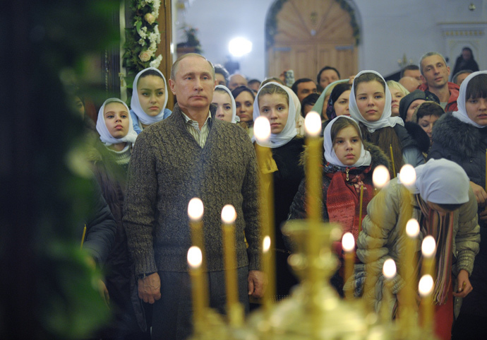 Russian President Vladimir Putin attends a Christmas Eve service at the Church of the Protection of the Blessed Virgin in the village of Otradnoye, Vornezh Region. (RIA Novosti / Alexei Druzhinin)