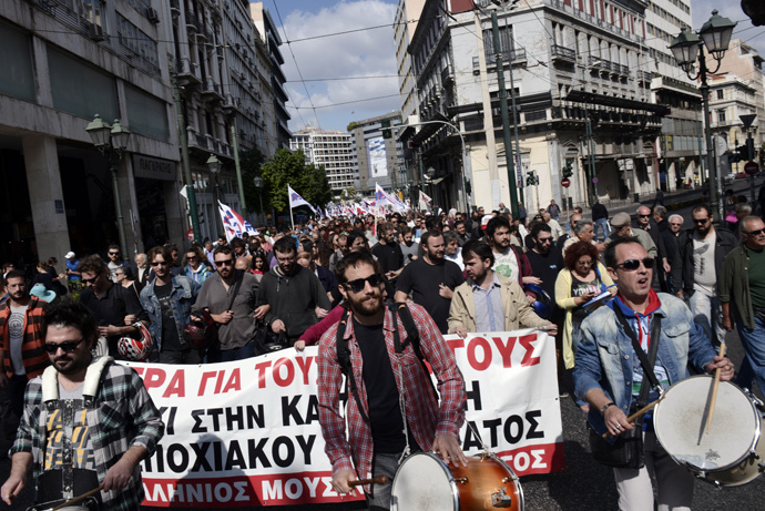 Communist affiliated protesters march in central Athens during a massive protest rally against unemployment and the austerity measures on October 4, 2014, as the country undergoes a new audit of its finance by the EU, IMF and the European Central Bank. (AFP Photo / Louisa Gouliamaki)