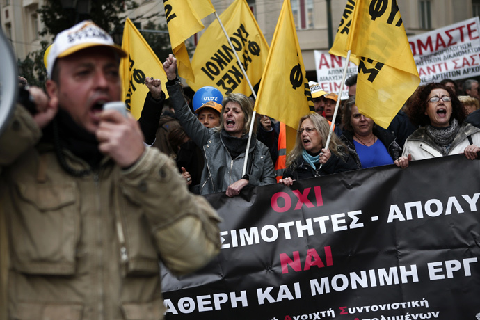 Protesters shout slogans during a 24-hour general strike in Athens November 27, 2014. (Reuters / Alkis Konstantinidis)