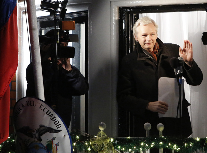 WikiLeaks founder Julian Assange gestures from the balcony of Ecuador's Embassy as he makes a speech, in central London (Reuters / Luke MacGregor)