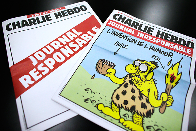 "A picture taken on September 25, 2012 in Paris shows today's two editions of French satirical magazine ""Charlie Hebdo"" one reading ""Irresponsible newspaper"" (R) and the other, bearing an empty front page reading ""responsible newspaper"" (AFP Photo)"