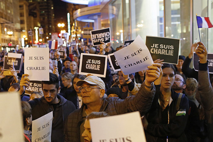 People gather for a vigil outside the Consulate General of France to remember the victims of an attack on satirical magazine Charlie Hebdo in Paris, in San Francisco, California January 7, 2015. (Reuters/Stephen Lam)