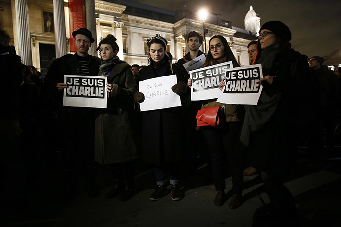 People attend a vigil at Trafalgar Square in London to pay tribute to the victims of a shooting in Paris. (Reuters/Stefan Wermuth)