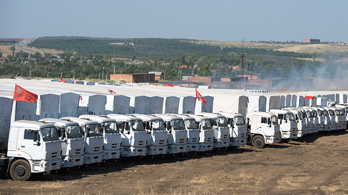 Trucks of Russian humanitarian convoy are parked in a field outside the town of Kamensk-Shakhtinsky in Rostov region, some 30 km from the Russian-Ukrainian border, Russia (AFP Photo / Dmitry Serebryakov)