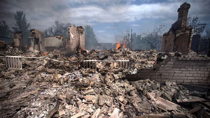 A view of a house destroyed in an air strike carried out by Ukrainian armed forces in the village of Stanitsa Luganskaya (AFP Photo)