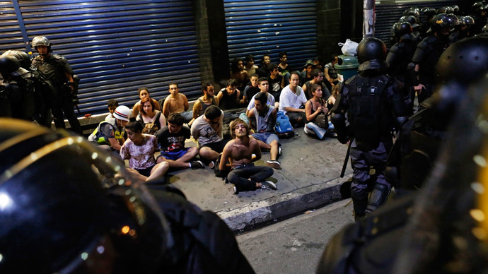 Demonstrators are detained by riot police during a protest against fare hikes for city buses, subway and trains in Sao Paulo January 9, 2015. (Reuters / Nacho Doce)
