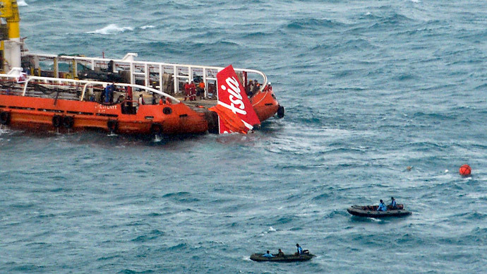 Tail of AirAsia flight lifted from seabed, black boxes still missing 27