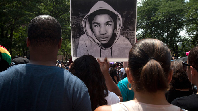An image of Trayvon Martin is displayed during a rally in New York.(Reuters / Carlo Allegri )
