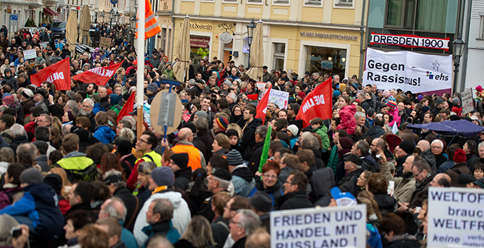 "Thousands of people take part in a rally themed ""For Dresden, for Saxony - living together in the sense of a global awareness, humanity and dialogue "" on January 10, 2015 in front of the Frauenkirche (Church of Our Lady) in Dresden, eastern Germany (AFP Photo / DPA)"