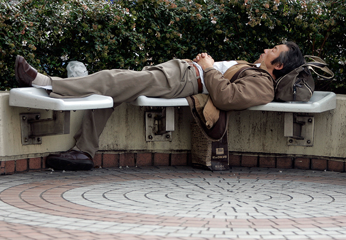 A man takes a nap on a bench in Tokyo (Reuters / Yuriko Nakao)