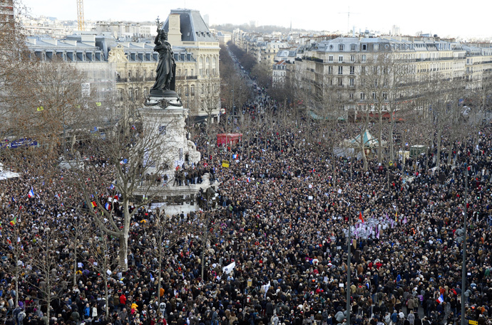 "People gather on the Place de la Republique (Republic Square) in Paris before the start of a Unity rally ""Marche Republicaine"" on January 11, 2015 in tribute to the 17 victims of a three-day killing spree by homegrown Islamists. (AFP Photo / Bertrand Guay)"