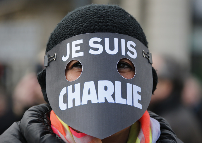 "A women wearing a mask reading ""I am Charlie"" takes part in a solidarity march (Marche Republicaine) in the streets of Paris January 11, 2015. (Reuters / Eric Gaillard)"
