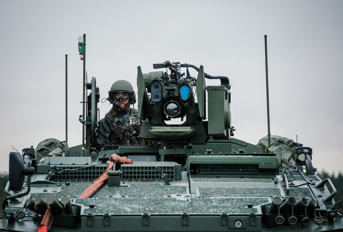 A soldier from the Swedish Armed Forces, looks on from top of the Patria XA-360 AMV (Armored Modular Vehicle) at Hagshult Airbase (AFP Photo / Jonathan Nackstrand)