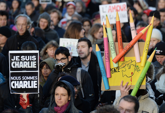 "A man holds a placard reading ""Je suis Charlie"" (I am Charlie) during a Unity rally ""Marche Republicaine"" on January 11, 2015 in Strasbourg, eastern France, in tribute to the 17 victims of the three-day killing spree. (AFP Photo / Patrick Hertzog)"