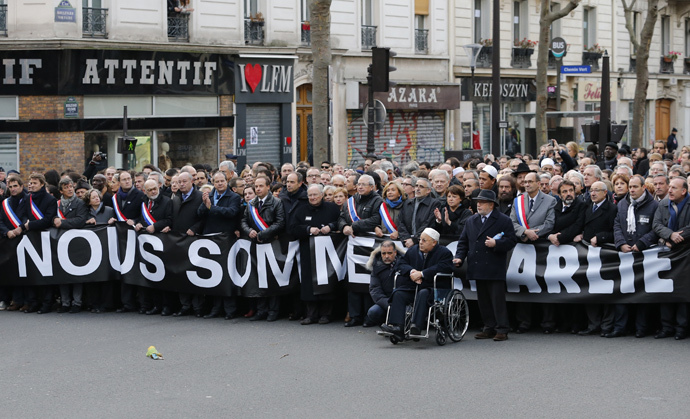Paris Mosque rector Dalil Boubakeur (front), French political, religious and personalites take part in a solidarity march (Marche Republicaine) in the streets of Paris January 11, 2015. (Reuters / Stephane Mahe)
