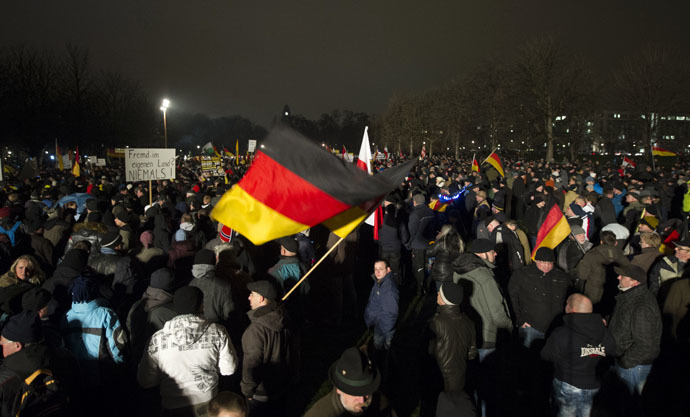 Demonstrators wave with German national flags during a rally by a mounting right-wing populist movement called Pegida on January 5, 2015 in Dresden, eastern Germany. (AFP Photo/Robert Michael)