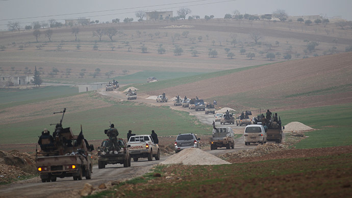 Members of al Qaeda's Nusra Front drive in a convoy as they tour villages, which they said they have seized control of from Syrian rebel factions, in the southern countryside of Idlib. (Reuters/Khalil Ashawi)