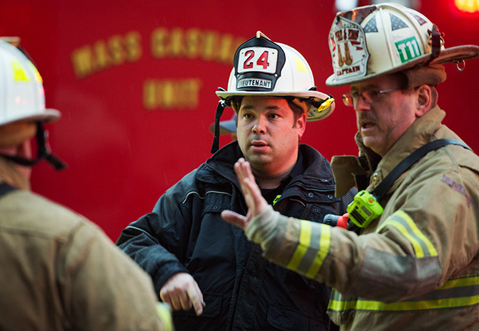 Firefighters confer after passengers on the Metro (subway) service were injured when smoke filled the L'Enfant Plaza station during the evening rush hour January 12, 2015 in Washington, DC. (AFP Photo/Paul J. Richards)