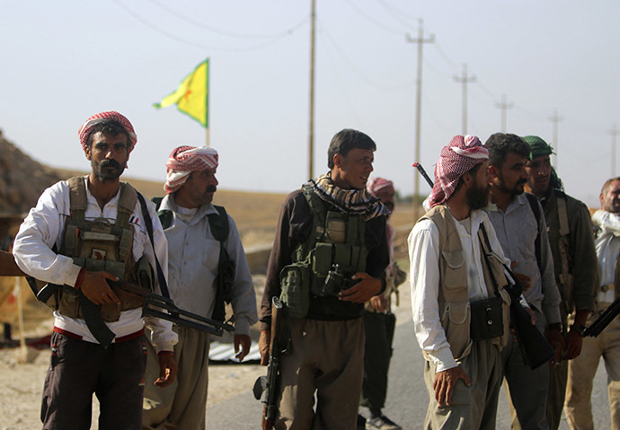 Yazidi fighters who recently joined the Kurdish People's Protection Units (YPG) secure a road in Mount Sinjar in northern Iraq. (Reuters/Rodi Said)