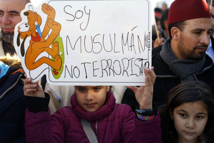 "A girl holds a placard that reads ""I am a Muslim, not a terrorist"" during a rally by members of the Muslim community of Madrid on January 11, 2015. (Reuters)"