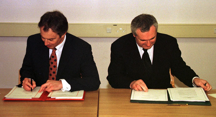 British Prime Minister Tony Blair (L) and Irish Prime Minister Bertie Ahern sign the peace agreement April 10, 1998 (Reuters)