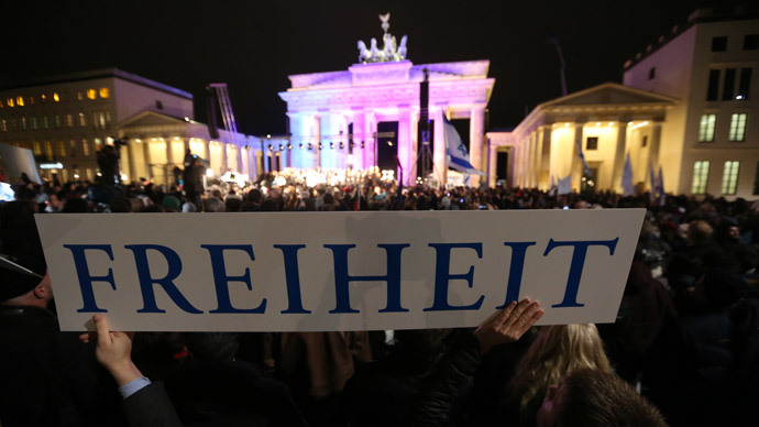 A banner reading 'Freedom' is seen during a Muslim community tolerance rally on January 13, 2015 in front of Brandenburg Gate in Berlin.(AFP Photo / Kay Nietfeld)
